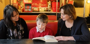 Judith Bunting reading with Finn and his mum, Kirilynn Gardner from Chaddleworth